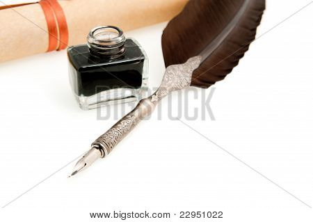 Feather Quill ,inkwell And Parchment Roll