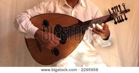 musician playing oud a stringed arabic