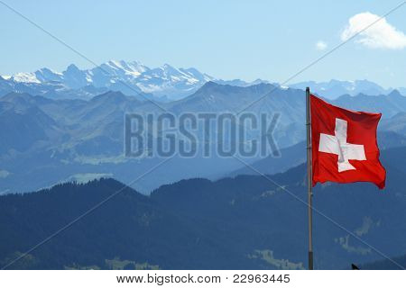 Swiss flag over Alps