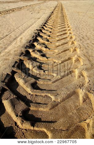 tractor tires  footprint printed on beach sand