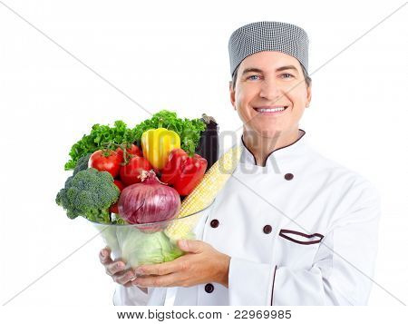 Smiling chef with vegetables.  Isolated over white background. Gourmet.