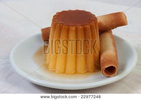 Cream caramel dessert on white dish
