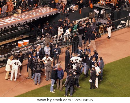 Giants Players Are Interviewed After Victory Outside Of The Dugout