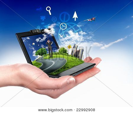 human hand holding notebook and nature landscape