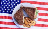 Chicken Salad Sandwich on am American flag. American Lunch. Food and drink concept.  poster