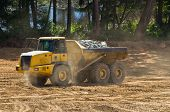 stock photo of dump_truck  - industrial dump truck working in construction site - JPG