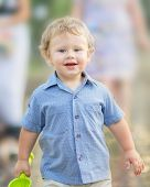 A Happy Smiling Baby Boy Playing At Summer Park. A Walking Family With A Cute Little Son Outside. Ou poster