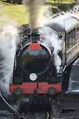 Beautiful Old Vintage Steam Railway Engine With Full Steam Blowing poster