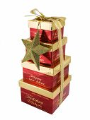 pic of christmas-present  - Christmas gift boxes stacked and tied with a ribbon isolated on a white background - JPG