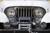 picture of off_road  - Front end headlights and grille on a vintage four - JPG