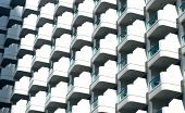 Glass Balconies On Modern Building Facade, Architecture Background. Real Estate, Property, House. Co poster