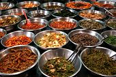 picture of kimchi  - Metal bowls full of various fermented vegetables  - JPG