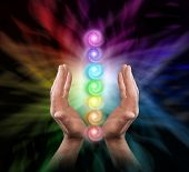 Sending Chakra Healing Energy - Male Parallel Hands Facing Upwards Against A Multicoloured Backgroun poster