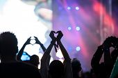 Crowd at concert - Heart shaped hands at concert, loving the artist and the festival poster