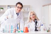 Two chemists having discussion in lab poster