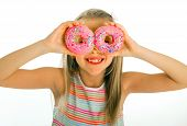 Young Beautiful Happy And Excited Blond Girl 8 Or 9 Years Old Holding Two Donuts On Her Eyes Looking poster