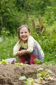 Little Girl Having Fun In The Garden, Planting, Gardening, Helping Her Mother. Happy, Natural Childh poster