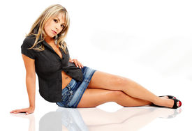 picture of mini-skirt  - blonde fashion woman modelling on the floor wearing a jean mini skirt and a black shirt  - JPG