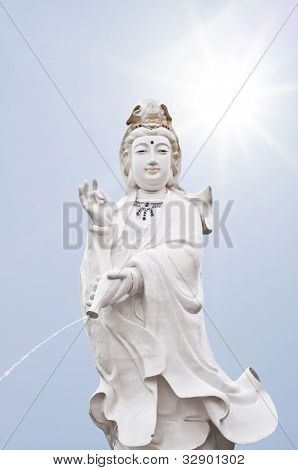 Quan Yin statue in sunlight.