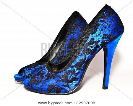 blue high heeled shoes on white