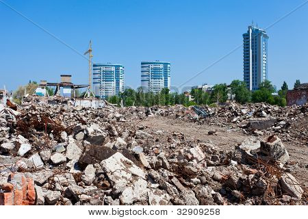 Pile Of Debris Of Ruined Building On New Buildings Background