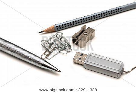 ballpoint pen pencil paper clip pencil sharpener and a flash card