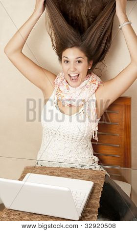 Girl Gone Crazy In Front Of Laptop