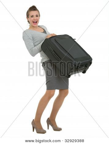 Tired Traveling Woman Raising Suitcase