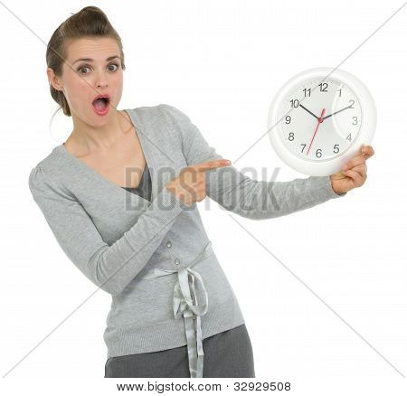 Shocked Business Woman Pointing On Clock