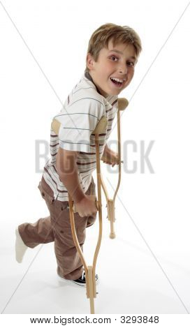 Smiling Boy On Crutches