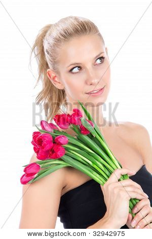 Beautiful Woman With Bouquet Of Red Tulips Flowers