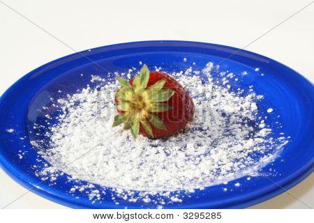 Single Strawberry On Blue Plate