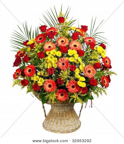 basket of roses, gerberas and palm leaves