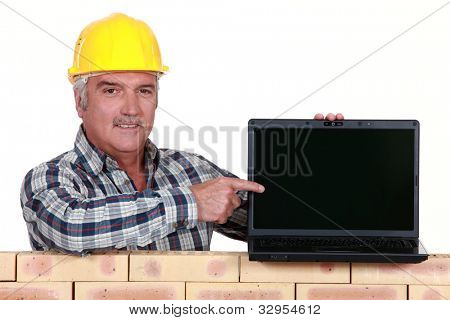 Manual worker with computer