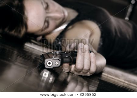 Gun In The Hand Of Dead Woman