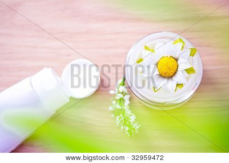 Flower Inside Pot Of Organic Moisturizer