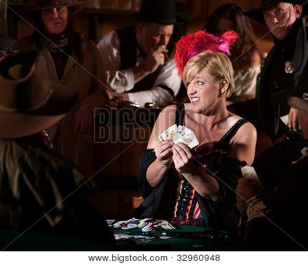 Woman Playing Cards In Saloon
