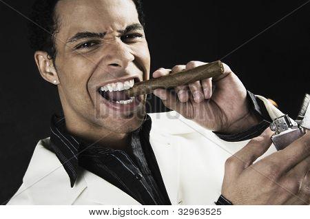 Mixed Race man lighting cigar