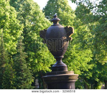 Urn On Leaning Column