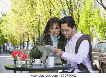 Hispanic couple looking at street map