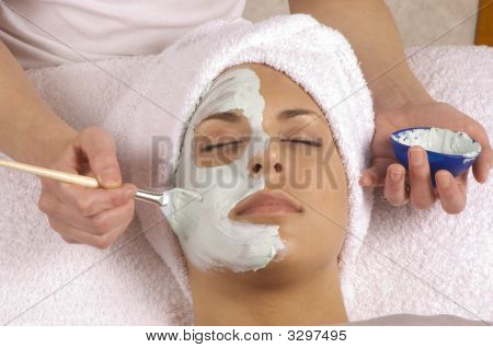 Spa Esthetician Applying Organic Facial Masque