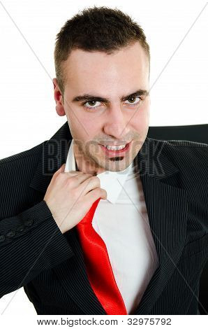 Angry Young Businessman Yanking Necktie