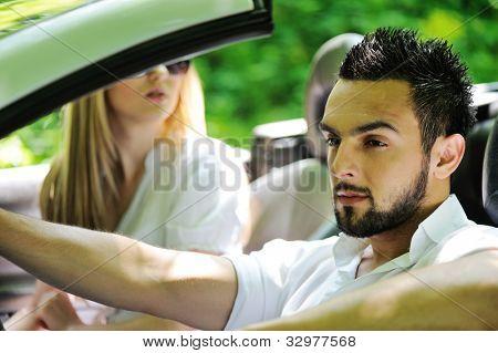 Friends in a sports car