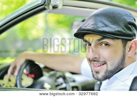Young guy behind the wheel