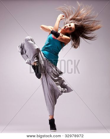 headbanging woman dancer standing on a leg in a full of energy dance move and screaming