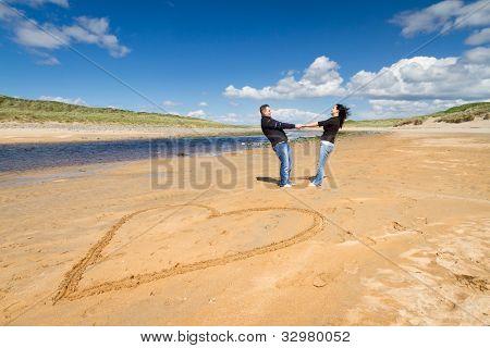 Loving couple on summer beach