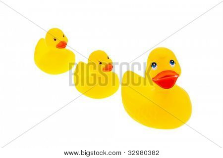 a yellow plastic duck on a white background with a cheerful face
