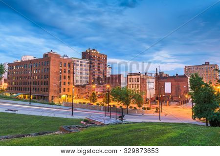 poster of Youngstown, Ohio, USA downtown road and townscape at twilight.