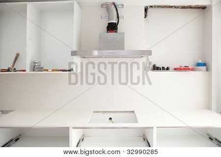 Interior design construction of a kitchen with cooker extractor fan hood