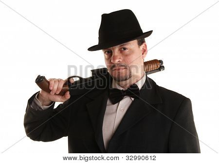 Mafia man is holding a shotgun
